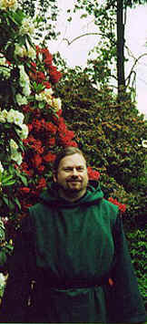 Monk Preston, bright red flowers, and bushes.