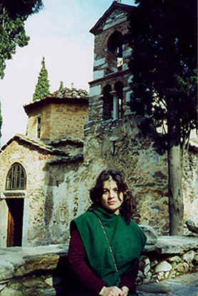 Photo: Copyright 2001 S.G.P.  All Rights Reserved.  Photo of Monk Linda, wearing a green surplice (part of her Monk's Habit) in front of a 1,000 year old monastery Church.