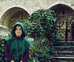 Photo: Copyright 2001 S.G.P.  All Rights Reserved.  Photo of Monk Linda with green Monk's hood up, in front of Monk cells at Kesariani Monastery.