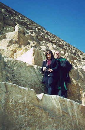Photo: of Monk Preston and Monk Linda climbing a pyramid and standing on massive 4' by 4' by 8' stone blocks.