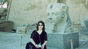 Photo: of Monk Linda in front of a giant stone head of the Pharaoh Ramses.