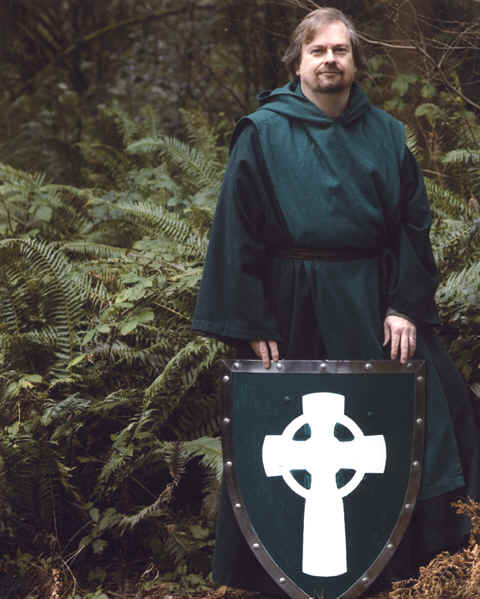 Photo: (Jan. 2008) - Monk Preston (S. G. Preston) with The Prayer Foundation Shield (Logo) on our Monastery grounds.  (Copyrighted) Photo by Leah Nash (leahnash.com).  Used by permission.
