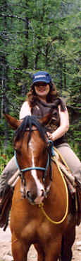 Phot: of Monk Linda riding a horse in the Canadian Rockies.  Photo Copyright 2006 S.G.P. All Rights Reserved.